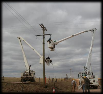 Several linemen crews work to repair 3-phase after storm damage.